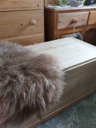 Lovely blonde pine kist 95cm by 50 cm £120. One lovely rare breed sheepskin £35