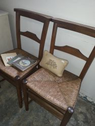 Two church chairs with bottom shelves £20 each