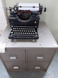 Heavy, old Royal Typewriter. Does work but a few keys stick £35  File cabinet £20